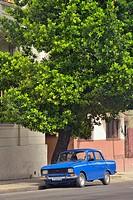 Street photography in central Havana- Colonial architecture with pedestrians and vehicles, La Habana (Havana), Habana, Cuba.
