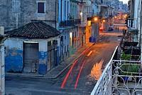 Street photogrphy in central Havana- Calle Escobar with dawn streetlights, La Habana (Havana), Habana, Cuba.