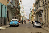 Street photography in central Havana- a sidestreet leading to the sea wall, La Habana (Havana), Habana, Cuba.
