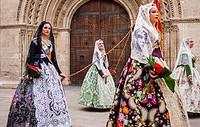 Flower offering parade,People with Floral tributes to `Virgen de los desamparados´, Fallas festival, Plaça de l´Almoina square,Valencia.