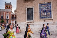 Flower offering parade,People with Floral tributes to `Virgen de los desamparados´, Fallas festival,Plaza Decimo Junio Bruto,Valencia.