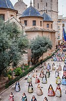 Flower offering parade,People with Floral tributes to `Virgen de los desamparados´, Fallas festival,carrer del Micalet street,Valencia.
