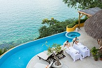 View from above at two women getting a massage on the terrace of an ocean front luxury wellness retreat in Mismaloya, Puerto Vallarta South Shore, Jal...
