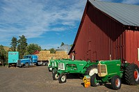 Old tractors in front of a barn in Whitman County in the Palouse, Washington State, USA.