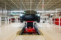 Tilburg, Netherlands. The electrical and environmental friendly Tesla Model S navigating independently towards a new assembly station inside the Europ...