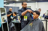 Detroit, Michigan - Young African-American men get haircuts at a job fair sponsored by the nonprofit My Brother's Keeper.