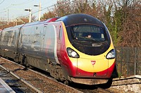 virgin trains british rail class 390 train 390 128 city of preston speeding along.