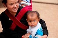 Woman with baby, Yunnan province, China