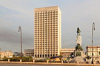 "Hermanos Ameijeiras Hospital (Hospital Clínico Quirúrgico """"Hermanos Ameijeiras"""") with the Antonio Maceo Statue in Central Havana, Cuba."