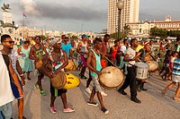 A group of musicians moving through Antonio Maceo Park in Central Havana, Cuba.