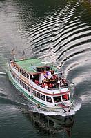 Ferryboat with backwash on Mosel River, Rhineland-Palatinate, Germany.