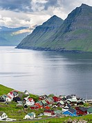 Village Funningur , in the background Funningsfjordur, Leiriksfjordur and the island Kalsoy. The island Eysturoy one of the two large islands of the F...