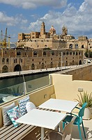 terrace of Nelli´s guesthouse on the harbour of Copiscua in front of Senglea, Three Cities, Malta, Southern Europe.