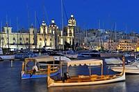 ´´Luzzu´´ in the port of Senglea (Isla) with Birgu´s Marina (Vittoriosa) in the background, Three Cities, Malta, Southern Europe.