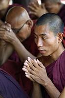 Myanmar, Bagan, Nat Taung kyaung monastery, Monks in prayer