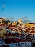 Portugal, Lisbon, Miradouro das Portas do Sol, View over Alfama Neighbourhood towards the National Pantheon at sunset.