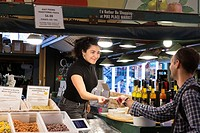 Seattle, Washington: Sophie helps a customer at Pappardelle's Pasta in Pike Place Market. Famous for its dark chocolate linguini, the shop has been a ...