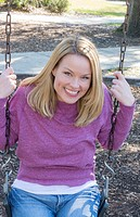 Young Mom woman at playground on swing portrait smiling with dimples Model Released, MR-6.