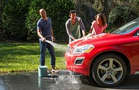 Family wash car at home black Caribbean dad son and daughter outside in sun red car fun together love Model Released, MR-16, MR-18, MR-20.