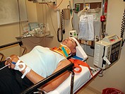 A woman in a hospital examination room after a car accident