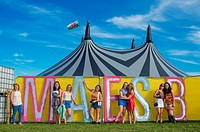 Young teenage girls enjoying themselves on the youth campsite (Maes B) at The National Eisteddfod of Wales , held near Meifod village in Powys, mid Wa...