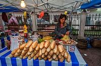 Selling popular fresh bread in Luang Phrabang night market, Laos.