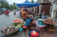 Selling foods, at Luang Phrabang, market. Laos.