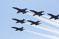 The US Navy and Marine Corps Blue Angels flight demonstration squadron flies over prior to the 2015 US Naval Academy Graduation and Commissioning Cere...