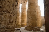Carved pillars, Built in yellow limestone. View of the great hypostyle hall in the Precinct of Amon Re, Situated at Karnak Temple complex, Comprises a...