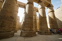 Carved pillars, Built in Yellow Limestone, View of the great hypostyle hall in the Precinct of Amon Re, Situated at Karnak Temple complex, Comprises a...