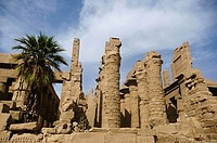 Inner view of a temple and carved pillars of the great hypostyle hall in the Precinct of Amon Re, Situated at Karnak Temple complex, Comprises a vast ...