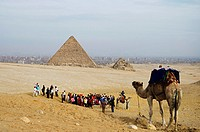 Giza pyramid complex. One of the Seven Wonders of the Ancient World Initially at 146. 5 metres, the Great Pyramid was the tallest man-made structure i...