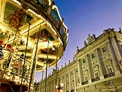 Christmas Carousel and Royal Palace, night view. Bailen street, Madrid, Spain.