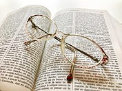 Eyeglasses on an open book.
