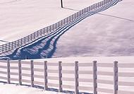 Fence line and shadows in snow, Nova Scotia, Canada.