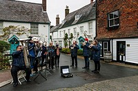 Lewes, Glynde and Beddingham Brass Band Perform In The High Street In The Lead Up To Christmas, Lewes, Sussex, UK.
