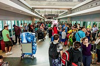 Florida, Miami, Miami International Airport, MIA Mover, automated people mover, platform, crowd, passengers, luggage, waiting, standing, families,