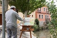 Peñafiel, Spain: Watercolor artist painting the old mill en plein air along the Duratón River in La Juderia Park.