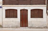 Peñafiel, Spain: Doorway in the Plaza del Coso with protective metal posts in place for the bullfight during the Fiestas de Nuestra Señora y San Roque...