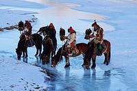 Mongolia, Bayan-Olgii province, Kazakh eagle hunter, Golden Eagle hunting in Altai mountains, winter season.