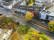 Aachen, Germany. View on a neighbourhood with road and traffic from a dormitory´s building 16th floor.