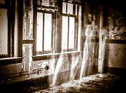 A ghostly figure of a woman in a white dress moving a room in an abandoned building.
