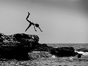 silhouettes girl jumping into the sea, Castellon