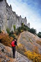 Walker walking the mountain, under the knives of the Quatretondeta Friars, Alicante, Valencia, Spain