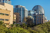 Downtown San Diego buildings including the metal dome of the Central Library. San Diego, California.