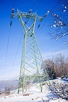 pylon of high voltage electricity with snow