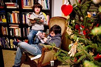 Children read a book in their living room