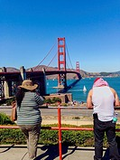 San Francisco, CA, USA, Couple Tourist , From Behind, Sightseeing at Golden Gate Brigde.