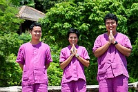 Employees of Six Senses Resort say hello. Six Senses Resort, Koh Yao Noi, Phang Nga Bay, Thailand, Asia. Bunglows in fornt of the Sea. Six Senses Yao ...