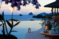 Six Senses Resort, Koh Yao Noi, Phang Nga Bay, Thailand, Asia. Romantic table in the restaurant near the swimming pool called The Hilltop Reserve in f...